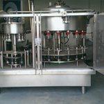 Máquina de llenado de botellas de perfume de presión negativa de 10 cabezales
